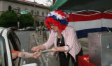 Deborah Gokey (cq), collects a ballot from a motorest, at the corner of Court and Colfax, Tuesday...