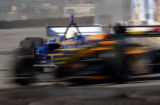 (DENVER, August 12, 2004) Champ Cars make there way around the track during practice Friday Aug....