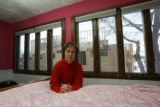 Ms. Aiello in her daughter's bedroom on the second floor overlooking the construction where a wide...