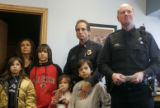 Denver Police officer Ted Block, left, surrounded by his wife and children (L-R) Sydney, Marci,...