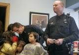 Denver Police officer Ted Block, left, surrounded by his children (L-R) Sydney, Christian,...