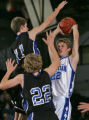 Grandview's Josh Riddle, top 11, and Stian Storgaard, bottom left #22, defend Denver Christian's...