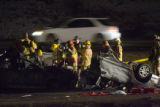 Fire crews and police attend to a accident on I-70 west bound near Lookout Mountain Tuesday...