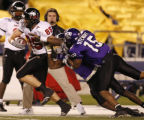 CALI108 - Northern Illinois wide receiver Matt Simon is pushed out-of-bounds by TCU's Torrey...