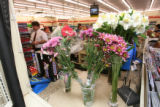 Flowers adorn the near door countertop of the 7-Eleven, 595 Havana St., Aurora, Colo., Tuesday...