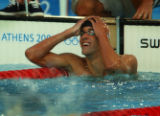 (Athens, Greece  on Saturday, Aug. 14, 2004) - U.S. swimmer Michael Phelps reacts to setting a a...