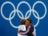 (Athens, Greece  on Saturday, Aug. 14, 2004) - U.S. swimmer Michael Phelps, right,  hugs teammate...