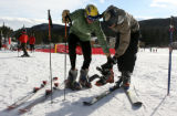 Brian Metzler, Boulder, and Dave Mackey, Boulder (left-right), swap ski gear, Tuesday Dec. 27,...