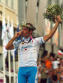 (ATHENS, GREECE, AUGUST 14, 2004)  Italy's Paeolo Bettini kisses his gold medal after winning the...