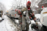 DENVER FIREFIGHTER DONNIE NVANES (CQ) OF TRUCK 11 WRAPS UP WATER HOSE AFTER A DUPLEX FIRE IN THE...