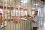 Joe Trujillo, an employee at a post office in downtown Denver, locks up the store due to an early...