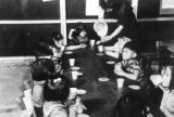 Elementary school children being served milk at Grenada-Amache Japanese Internment Camp.   ...
