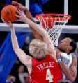Atlanta Hawks Matt Freije, left, gets blocked by Denver Nuggets center Marcus Camby, right, in the...