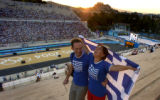 (ATHENS, GREECE-AUGUST 29, 2004) Max Montini and his wife Evi Spantidaki enjoy the sunsetting...