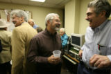 (DLM3208) -   Steven Goolsby, center, talks with Frank Lombardi as dozens of people gather in one...