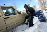 MJM304  Tommy Watkins (cq) helps shovel out the vehicle belonging to Sheryl Rhea (cq) parked on...