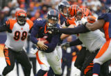In the first quarter, the Denver Broncos Jay Cutler (#6, QB) tries to escape the grasp of the...