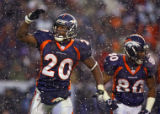 In the third quarter, the Denver Broncos Mike Bell (#20, RB) salutes the fans after scoring a...