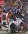 In the Fourth quarter, Denver Broncos defensive linemen Elvis Dumervil tries to gain yards after a...