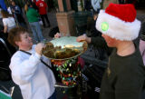 Lyndy Sullivan (cq), left, helps her son Eric Sullivan decorate his Bass Tuba for the 32nd annual...