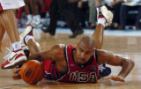 (ATHENS, GREECE, AUGUST 15, 2004)  Team USA's Tim Duncan dives for a loose ball during action...