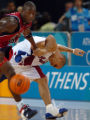 (ATHENS, GREECE, AUGUST 15, 2004) Puerto Rico's #7, Carlos Arroyo, right, battles with Team USA's...