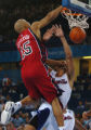 (ATHENS, GREECE, AUGUST 15, 2004) Puerto Rico's #4, Jose Ortiz, right, gets a face full of Team...