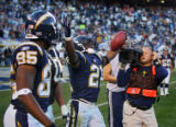 In the fourth quarter, the San Diego Chargers LaDanian Tomlinson (#21) celebrates after scoring...