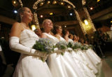 Caroline Taylor, left, Lillian Schlosser, and the rest of the debutantes line up following their...