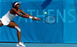 (ATHENS, GREECE - AUGUST 15, 2004)  USA's Venus Williams lunges for a volley from Hungary's...
