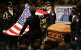 Members of the Honor Guard hold the flag covering officer Kenneth C. Jordan's casket during a 21...