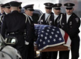 Members of the Honor Guard unload  officer Kenneth C. Jordan's casket  as fellow officers,  family...