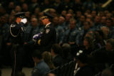 MJM368  Colorado Springs Interim Police Chief Dave Felice holds the flag from the coffin of slain...