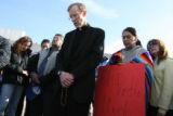Father Bernie Schmitz, cq, of Our Lady of Peace Catholic Church in Greeley holds prayer with...
