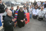 Father Bernie Schmitz, cq, of Our Lady of Peace in Greeley holds prayer with family members of...