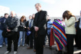 Father Bernie Schmitz, cq, of Our Lady of Peace Catholic church in Greeley, Colo., holds prayer...