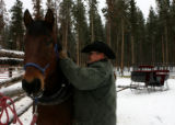 Andy Markel (cq - right) gets Bart ready for a sleigh ride Monday morning December 12, 2006 at...