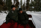 A couple from Granby, Dustin Keesling (cq), left, and Nikki Morrow (cq), enjoy a sleigh ride...