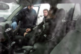 Paramedics from AMR examines a motorist injured in a 25 car pile up, on north bound I-25 at the...