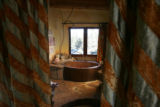 JPM027 - Drapes frame the master bathroom.  Alice Starek is a Princeton-trained architect and...