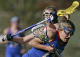 Cherry Creek's Perrie White, right, surges to the goal being defended by Kent Denver's Kelly...