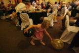Tula Smith,4, tries to get as many balloons as possible to play catch with any family member...