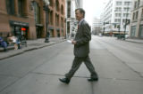 BG0089 Denver Mayor John Hickenlooper walks across 17th street and smiles as constituents waiting...