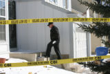 A Coloroad Bureau of Investigations investigator enters the house at 705 Brome Place in Lafayette...