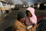 MJM366  Julio Ramirez, standing with daughter, Alexandria Ramirez, 4, talks Thursday outside he...