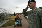 Lt. Joseph Lane (cq), of the Bravo company 64th BSB, salutes during the 3rd Heavy Brigade Combat...