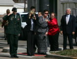 Mourners watch from the street as the casket of Army Spc. Blake Harris, 22, is loaded onto a...