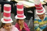 "Wearing homemade ""Cat in the Hat"" hats, first graders from North Elementary School in..."