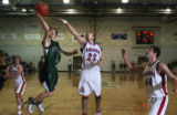 (from left) D'Evelyn's Jeremy Sullivan attempts a shot at the basket as Steamboat's Michael...