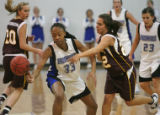 (center) Broomfield's Chaundra Sewell and Windsor's Mallory Duran scramble for the ball in a game...